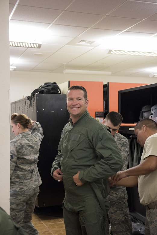 Rich Sykes, Mountain Home mayor, gets fitted for his flight suit June 1, 2017, at Mountain Home Air Force Base, Idaho. This was Sykes first time flying in an F-15E Strike Eagle.(U.S. Air Force Photo by Senior Airman Jeremy L. Mosier)