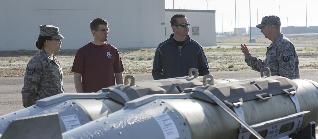 Rich Sykes, Mountain Home mayor, receives a brief from Tech. Sgt. June 2, 2017, at Mountain Home Air Force Base. After living in Mountain Home for 15 years, this was the first time Sykes had visited the munitions storage area at Mountain Home AFB.(U.S. Air Force Photo by Senior Airman Jeremy L. Mosier)