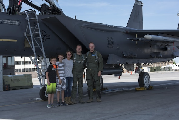 Col. Jefferson O'Donnell, 366th Fighter Wing commander, poses for a photo with Rich Sykes, Mountain Home mayor, and his family, June 2, 2017, at Mountain Home Air Force Base, Idaho. Sykes' family was there to watch him take off and land during his orientation flight.(U.S. Air Force Photo by Senior Airman Jeremy L. Mosier)