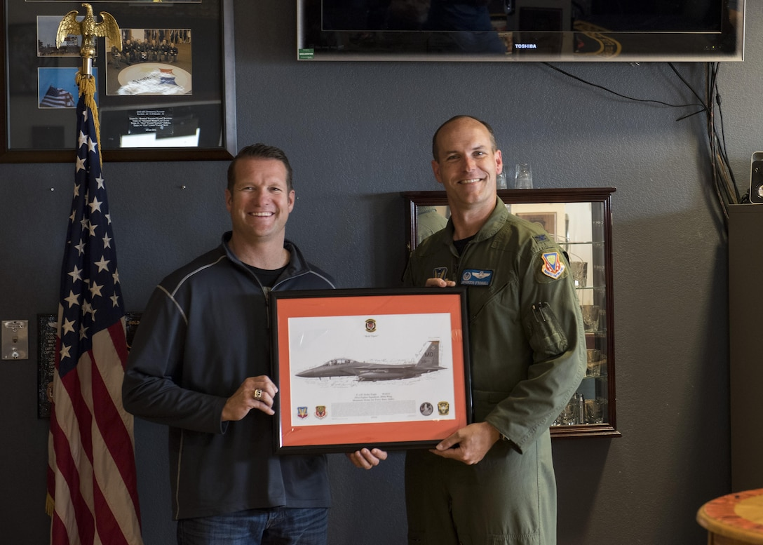 Col. Jefferson O'Donnell, 366th Fighter Wing commander, poses for a photo with Rich Sykes, Mountain Home mayor, June 2, 2017, at Mountain Home Air Force Base, Idaho. O'Donnell presented Sykes with a photo of an F-15E Strike Eagle that was signed by the aircrew after his orientation flight.(U.S. Air Force Photo by Senior Airman Jeremy L. Mosier)