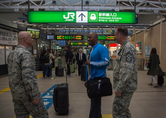 Chief Master Sgt. of the Air Force Kaleth O. Wright is greeted by Col. R. Scott Jobe, 35th Fighter Wing commander, and Chief Master Sgt. Chuck Frizzell, 35th FW command chief, at the train station in Hachinohe, Japan, June 8, 2017. During his visit, Wright spoke with 35th FW Airmen, addressing their concerns and critical roles within Pacific Air Forces. Wright also dedicated time mentoring junior and senior enlisted Airmen. (U.S. Air Force photo by Senior Airman Deana Heitzman)