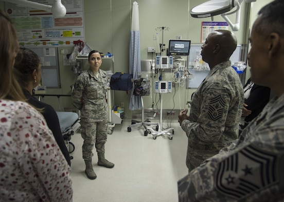 Chief Master Sgt. of the Air Force Kaleth O. Wright listens to a 35th Medical Group brief given by Tech. Sgt. Sarah Lopez, 35th Medical Operations Squadron unit care center chief, during his Pacific Air Forces' immersion tour at Misawa Air Base, Japan, June 9, 2017. During his visit, Wright spoke with 35th Fighter Wing Airmen, addressing their concerns and critical roles within Pacific Air Forces. Wright also dedicated time mentoring junior and senior enlisted Airmen. (U.S. Air Force photo by Senior Airman Deana Heitzman)
