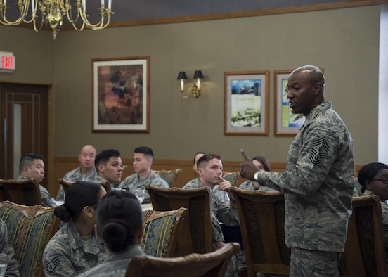 Chief Master Sgt. of the Air Force Kaleth O. Wright speaks with NCO's during his Pacific Air Forces' immersion tour at Misawa Air Base, Japan, June 9, 2017. During his visit, Wright spoke with 35th Fighter Wing Airmen, addressing their concerns and critical roles within Pacific Air Forces. Wright also dedicated time mentoring junior and senior enlisted Airmen. (U.S. Air Force photo by Senior Airman Deana Heitzman