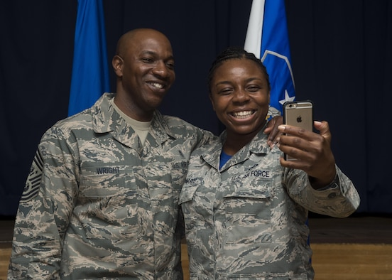 Chief Master Sgt. of the Air Force Kaleth O. Wright takes a selfie with Staff Sgt. Bennita Edwards, 35th Fighter Wing protocol NCO in charge, during his Pacific Air Forces' immersion tour at Misawa Air Base, Japan, June 9, 2017. Wright toured various work centers, focusing his visit on innovative Airmen who contribute to the overall growth of the Air Force. He also sat with Airmen and NCO's to learn more about their concerns about the Air Force. (U.S. Air Force photo by Senior Airman Deana Heitzman)