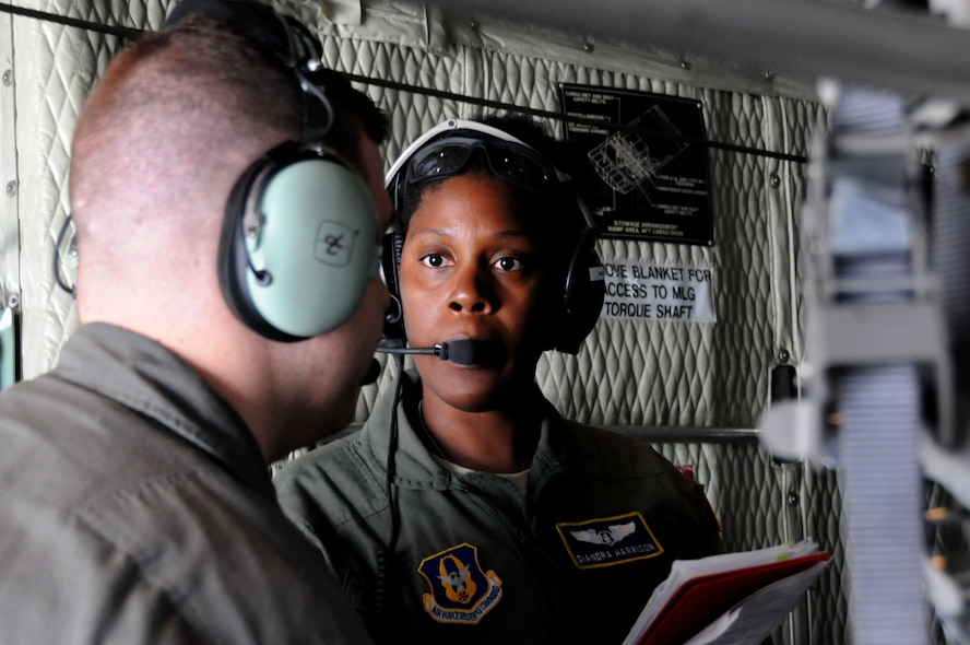 Capt. Diandra Harrison, a flight nurse with the 445th Aeromedical Evacuation Squadron here, communicates with a fellow Citizen Airman during a joint training mission here, June 7, 2017. The 445th AES trained for two hours while airborne to simulate a real-world scenario. (U.S. Air Force photo/Senior Airman Joshua Kincaid)