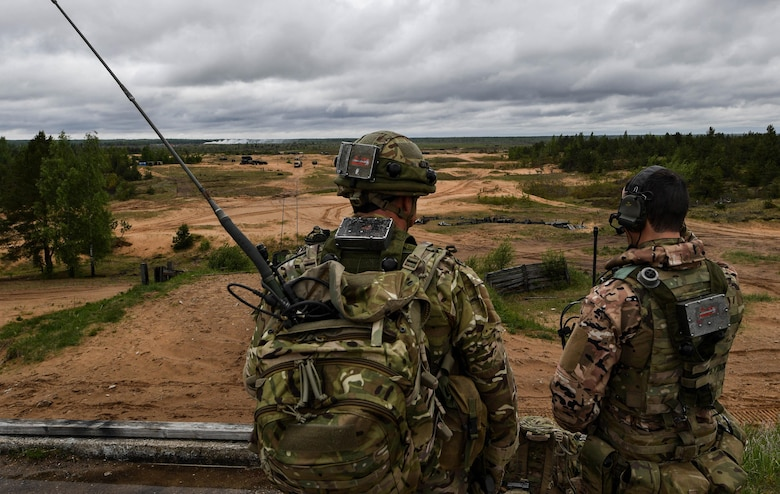 Great Britain Royal Marine joint terminal attack controllers call in military aircraft during exercise Saber Strike 17 at Adazi Military Base, Latvia, June 5, 2017. During the exercise, U.S. and NATO JTACs controlled air strike operations with U.S. Air Force F-16 Fighting Falcons, a B-52 Stratofortress, and a B-1B Lancer. Saber Strike 17 highlights the inherent flexibility of ground and air forces to rapidly respond to crises allowing for the right presence where it is needed, when it is needed. (U.S Air Force photo by Senior Airman Tryphena Mayhugh)