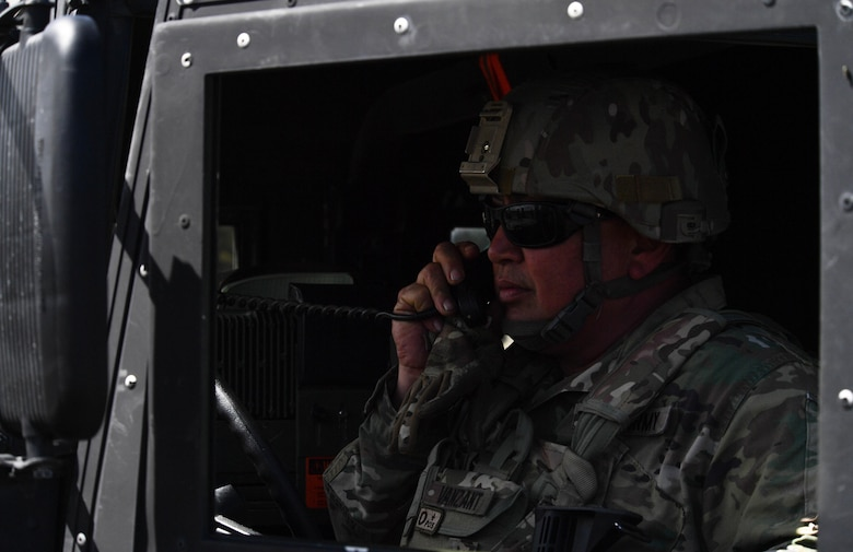 U.S Army National Guard Master Sgt. Samuel Vanzant, 3rd Battalion, 157th Field Artillery operations noncommissioned officer, calls in three good missile launches to U.S. and NATO joint terminal attack controllers during exercise Saber Strike 17 at Adazi Military Base, Latvia, June 9, 2017. The U.S. and NATO JTACs worked alongside each other throughout the exercise. Participation in multinational exercises such as Saber Strike enhances professional relationships and improves overall coordination with allies and with partner militaries during times of crisis. (U.S Air Force photo by Senior Airman Tryphena Mayhugh)