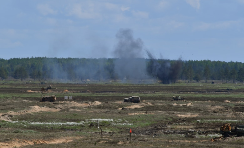 An explosion goes off on a range during exercise Saber Strike 17 at Adazi Military Base, Latvia, June 9, 2017. U.S. and NATO joint terminal attack controllers coordinated air assaults from U.S. Air Force F-16 Fighting Falcons, a B-52 Stratofortress, and a B-1B Lancer during the exercise. Saber Strike 17 highlights the inherent flexibility of ground and air forces to rapidly respond to crises allowing for the right presence where it is needed, when it is needed.  (U.S Air Force photo by Senior Airman Tryphena Mayhugh)