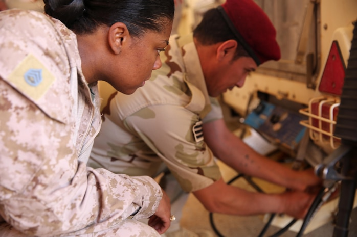 U.S. Marine Corps Staff Sgt. Shakelia Woods, a food service specialist with Special Purpose Marine Air-Ground Task Force-Crisis Response-Central Command, observes an Iraqi soldier with the 7th Iraqi Army Division conduct a maintenance check on an Ozti Field Kitchen (OFK) during an advise and assist mission in support of Task Force Al Asad in Iraq May 4, 2017. Task Force Al Asad trains Iraqi forces with operationally relevant training, an integral aspect of Combined Joint Task Force-Operation Inherent Resolve, the global coalition to defeat ISIS in Iraq and Syria. (U.S. Marine Corps photo by Staff Sgt. Jennifer B. Poole)
