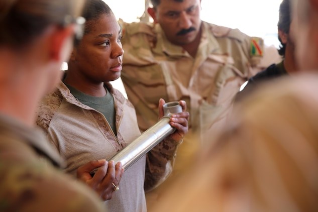 U.S. Marine Corps Staff Sgt. Shakelia Woods, a food service specialist with Special Purpose Marine Air-Ground Task Force-Crisis Response-Central Command, discusses preventive maintenance on an Ozti Field Kitchen (OFK) to Iraqi soldiers with the 7th Iraqi Army Division during an advise and assist mission in support of Task Force Al Asad in Iraq May 4, 2017. Task Force Al Asad trains Iraqi forces with operationally relevant training, an integral aspect of Combined Joint Task Force-Operation Inherent Resolve, the global coalition to defeat ISIS in Iraq and Syria.(U.S. Marine Corps photo by Staff Sgt. Jennifer B. Poole)