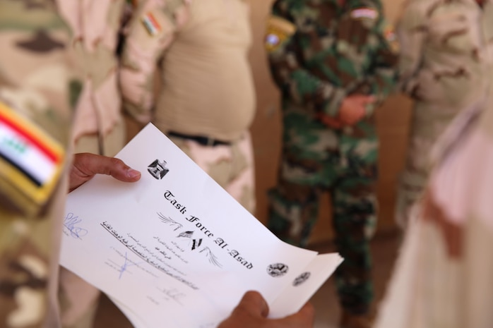An Iraqi soldier with the 7th Iraqi Army Division holds a certificate of accomplishment after completing a week-long course on capabilities and employment of an Ozti Field Kitchen (OFK) taught by U.S. Marine Corps Staff Sgt. Shakelia Woods, a food service specialist with Special Purpose Marine Air-Ground Task Force-Crisis Response-Central Command, April 30-May 4, 2017. Task Force Al Asad trains Iraqi forces with operationally relevant training, an integral aspect of Combined Joint Task Force-Operation Inherent Resolve, the global coalition to defeat ISIS in Iraq and Syria.(U.S. Marine Corps photo by Staff Sgt. Jennifer B. Poole)