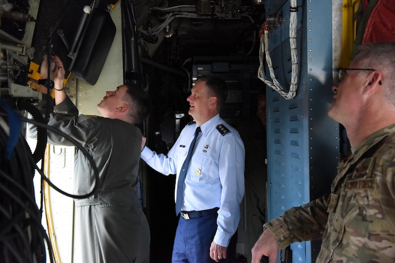 U.S. Air Force Lt. Gen. Brad Webb (center), commander of Air Force Special Operations Command, and Chief Master Sgt. Gregory Smith, command chief master sergeant of Air Force Special Operations Command, listen to Master Sgt. Stanley Hain, 193rd Special Operations Wing loadmaster, brief on ground egress aboard an EC-130J Solo aircraft at Middletown, Pennsylvania, June 9, 2017. Webb flew the solo to the 193rd Air Operations Group at State College, Pennsylvania, the following day. (U.S. Air National Guard photo by Master Sgt. Culeen Shaffer/Released)