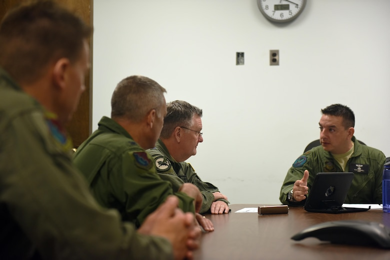 Major Todd Campbell, a pilot with the 193rd Special Operations Group, Middletown, Pennsylvania, briefs U.S. Air Force Lt. Gen. Brad Webb (front left), commander of Air Force Special Operations Command, on his plans for flying the EC-130J Commando Solo June 10, 2017. Webb is a command pilot with more than 3,700 flying hours, including 117 combat hours in Afghanistan, Iraq and Bosnia. (U.S. Air National Guard photo by Senior Airman Julia Sorber/Released)