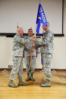 Lt. Col. Brian McMorrow, right, officially takes command of the 123rd Medical Group Detachment 1, CERFP, by accepting the unit's guidon from Col. Michael Cooper, commander of the 123rd Medical Group, during a ceremony at the Kentucky Air National Guard Base in Louisville, Ky., May 20, 2017. The detachment is the medical component of a joint Kentucky National Guard disaster-response team. (U.S. Air National Guard photo by Tech. Sgt. Vicky Spesard)