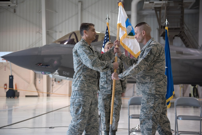 Chief Master Sgt. Ray Dawson (right) accepts the guidon of Headquarters, Kentucky Air National Guard, from Brig. Gen. Warren Hurst, Kentucky's assistant adjutant general for Air, to become the Commonwealth's newest state command chief during a ceremony at the Kentucky Air National Guard Base in Louisville, Ky., April 22, 2017. Dawson replaces Chief Master Sgt. Jeff Moore, who is retiring after more than 35 years of service to the United States Air Force and Kentucky Air Guard. (Kentucky Air National Guard photo by 1st Lt. James W. Killen)