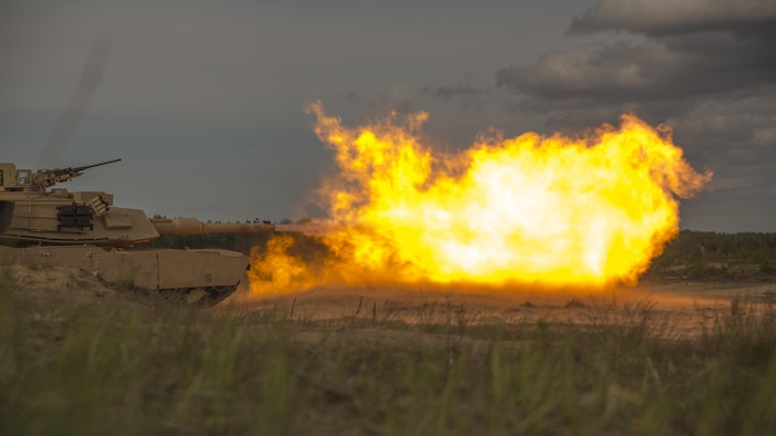 Marines with Alpha Company, 4th Tank Battalion, 4th Marine Division, Marine Forces Reserve, fire from a M1 Abrams tank during Exercise Saber Strike 17 in the Adazi Training Area, Latvia, June 4, 2017. Exercise Saber Strike 17 is an annual combined-joint exercise conducted at various locations throughout the Baltic region and Poland. The combined training exercise keeps Reserve Marines ready to respond in times of crisis, by providing them with unique training opportunities outside of the continental United States.