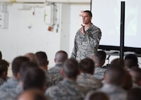 Chief Master Sgt. Russell Louk, 15th Wing, Hickam Air Force Base, Hawaii, speaks to members of the 132d Wing Iowa Air National Guard on June 10, 2017, at the Des Moines Airbase. Louk shared his personal story of resiliency as well as tips on how to improve it. (U.S. Air National Guard photo by Staff Sgt. Michael J. Kelly)
