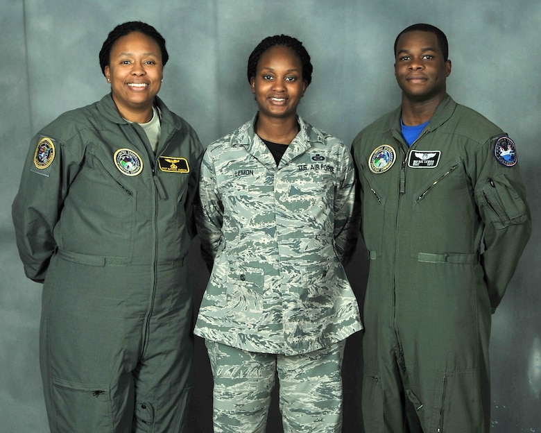 (L to R) Pictured are siblings Master Sgt. Natasha Johnson and Master Sgt. Terri Lemon and Terri's husband Master Sgt. Mo'rel Lemon. They are all stationed at Offutt Air Force Base, Nebraska, and their family is tied together in many unique ways including rank and career field. (U.S. Air Force photo by Charles Haymond)