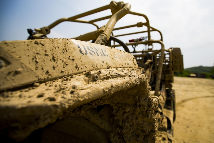 U.S. Marines assigned to Weapons Company, 3rd battalion, 8th Marine Regiment, forward deployed to the 3rd Marine Division, as part of the forward Unit Deployment Program, utilize the Utility Task Vehicle and explore its capabilities at Story Live Fire Complex South Korea, June 9, 2017. The UTV is the most recent advancement in the capabilities and mobility of marines.