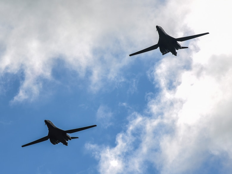 Two B-1B Lancers from Ellsworth Air Force Base, S.D., fly over Royal Air Force Fairford, U.K., June 8, 2017. Aircrew from the 37th Bomb Squadron are participating in bomber assurance and deterrence missions in the European theatre that provide bomber crews opportunities to train with allies and partners in joint and multinational exercises such as BALTOPS and Saber Strike. (U.S. Air Force photo by Airman 1st Class Randahl J. Jenson)
