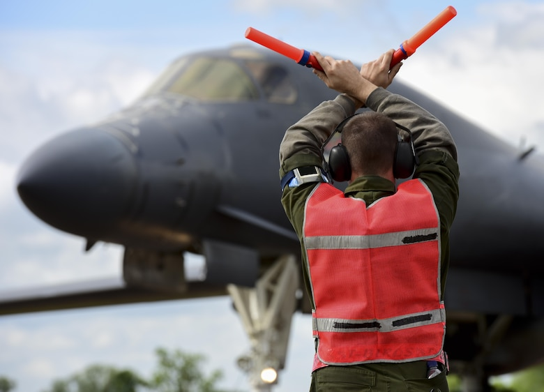 U.S. Air Force Airman 1st Class Jacob Feeback, 28th Aircraft Maintenance Squadron crew chief, marshals in a B-1B Lancer from Ellsworth Air Force Base at Royal Air Force Fairford, U.K., June 7, 2017. Airmen from the 28th Aircraft Maintenance Squadron are supporting bomber assurance and deterrence missions in the European theatre that combine training opportunities and greatly improve interoperability among participating NATO allies and regional partners. (U.S. Air Force photo by Airman 1st Class Randahl J. Jenson)