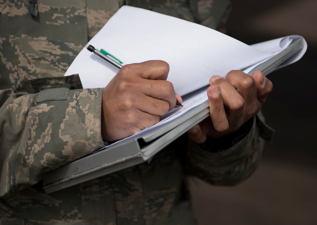 U.S. Air Force Tech. Sgt. Bobby McMillian, 28th Aircraft Maintenance Squadron expediter, updates a munitions tracking sheet at Royal Air Force Fairford, U.K., June 7, 2017. Airmen from Ellsworth Air Force Base, S.D., are participating in bomber missions in the European theatre that provide opportunities to train with allies and partners in joint and multinational exercises such as BALTOPS and Saber Strike. (U.S. Air Force photo by Airman 1st Class Randahl J. Jenson)