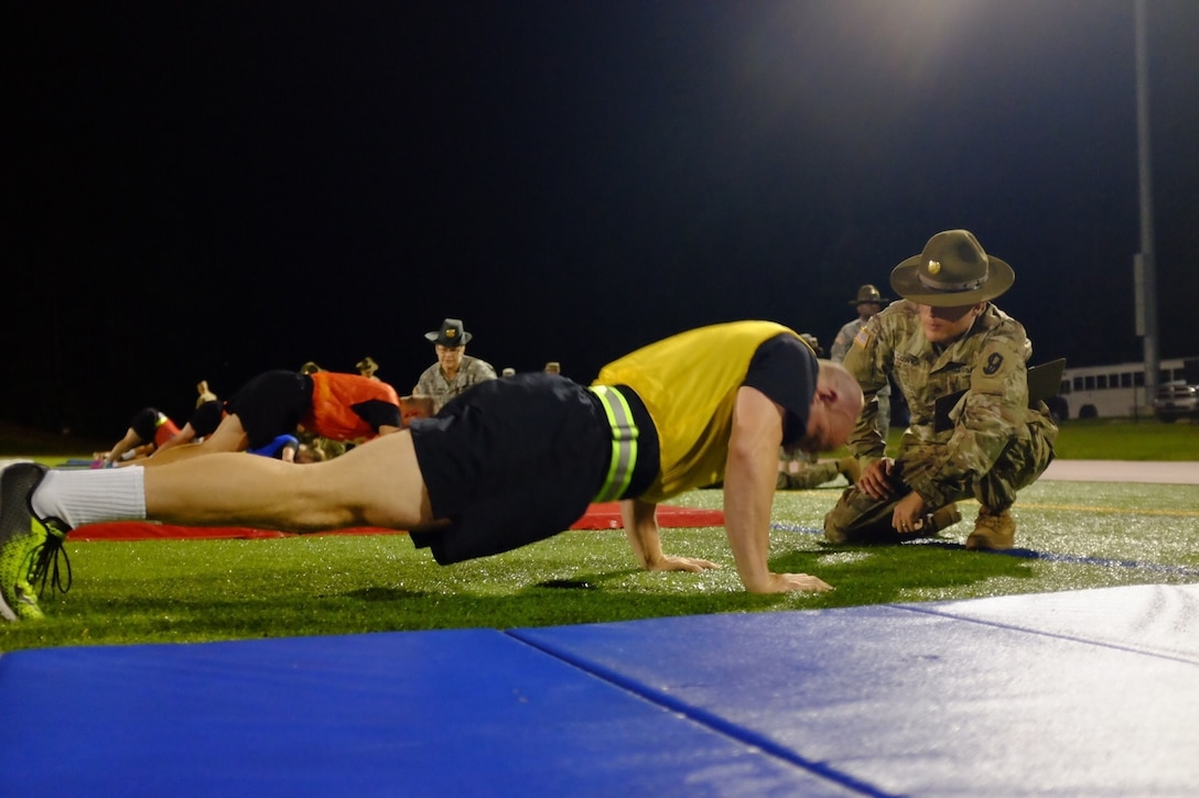 A U.S. Army Reserve Best Warrior candidate competes in the push-up event during the Army Physical Fitness Test at the 2017 U.S. Army Reserve Best Warrior Competition at Fort Bragg, N.C., June12. This year's Best Warrior Competition will determine the top noncommissioned officer and junior enlisted Soldier who will represent the U.S. Army Reserve in the Department of the Army Best Warrior Competition later this year at Fort A.P. Hill, Va. (U.S. Army Reserve photo by Timothy L. Hale) (Released)