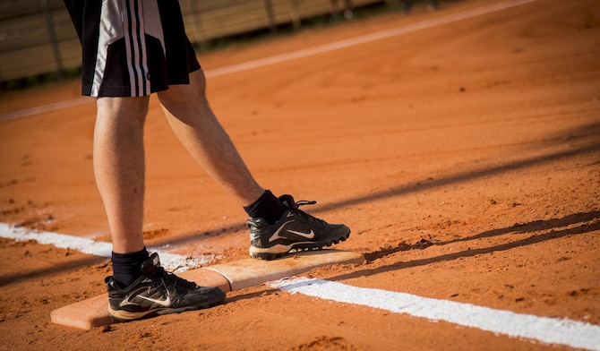 A runner steps on first base during an intramural softball game at Eglin Air Force Base, Fla., June 8.  The Armament Directorate team bashed the hapless Air Force Research Lab team 14-4 in five innings of play.  (U.S. Air Force photo/Samuel King Jr.)
