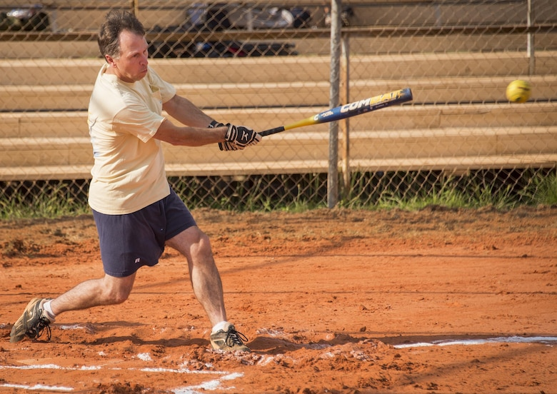 The Armament Directorate team's Mike Kelton swings for the fences during an intramural softball game at Eglin Air Force Base, Fla., June 8.  The EB team bashed the hapless Air Force Research Lab team 14-4 in five innings of play.  (U.S. Air Force photo/Samuel King Jr.)