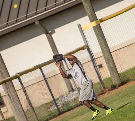 The Air Force Research Lab team's Willie Whitley reaches up to catch a fly ball during an intramural softball game at Eglin Air Force Base, Fla., June 8.  The Armament Directorate team bashed the hapless AFRL team 14-4 in five innings of play.  (U.S. Air Force photo/Samuel King Jr.)