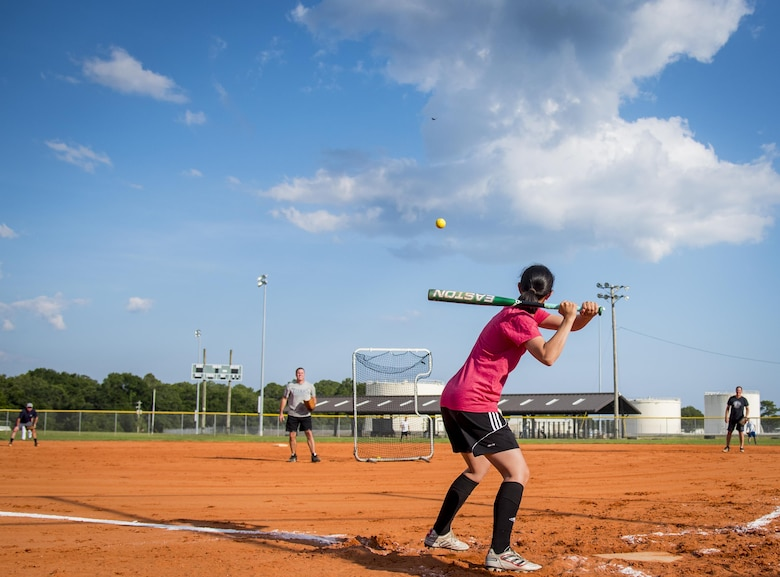 An Air Force Research Lab team member takes her turn at bat during an intramural softball game at Eglin Air Force Base, Fla., June 8.  The Armament Directorate team bashed the hapless AFRL team 14-4 in five innings of play.  (U.S. Air Force photo/Samuel King Jr.)