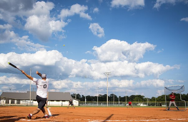 An Armament Directorate team member swings for the fences during an intramural softball game at Eglin Air Force Base, Fla., June 8.  The EB team bashed the hapless Air Force Research Lab team 14-4 in five innings of play.  (U.S. Air Force photo/Samuel King Jr.)