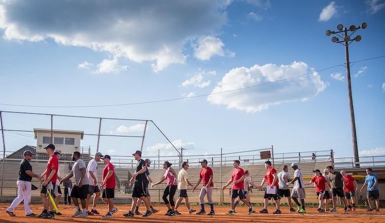 The first Thursday intramural softball game comes to an end under a blue sky at Eglin Air Force Base, Fla., June 8.  The Armament Directorate team (left) bashed the hapless Air Force Research Lab team (right) 14-4 in five innings of play.  (U.S. Air Force photo/Samuel King Jr.)