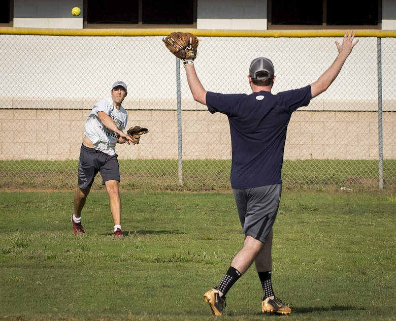 The Armament Directorate team's outfielder throws to his cut-off man during an intramural softball game at Eglin Air Force Base, Fla., June 8.  The EB team bashed the hapless Air Force Research Lab team 14-4 in five innings of play.  (U.S. Air Force photo/Samuel King Jr.)