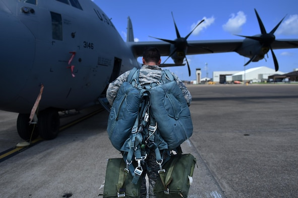 Tech Sgt. Jacob Long, 19th Operations Support Squadron Aircrew Flight Equipment craftsman, loads survival equipment onto a C-130J June 6, 2017, at Little Rock Air Force Base, Ark. The 19th OSS equipment specialists work 24/7 to prepare gear for all operations ranging from tactical airdrops to emergency landings. (U.S. Air Force photo by Airman 1st Class Kevin Sommer Giron)