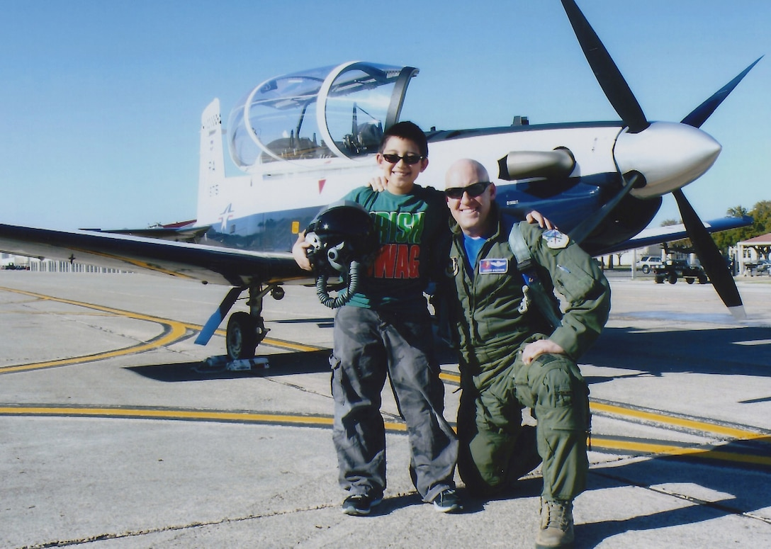 "Lt. Col. Andrew ""Kisser"" Kissinger, 39th Flying Training Wing T-6 Texan instructor pilot poses with his son Nicholas Kissinger in front of a T-6 Texan at JBSA-Randolph."