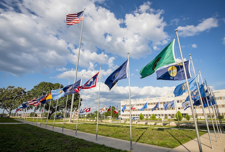 Flags of every state and the American flag flap in the breeze in front of the 96th Test Wing headquarters building.  Flag Day is celebrated in America on June 14.  National Flag Day began in 1949 and commemorates the adoption of the U.S. Flag on June 14, 1777. (U.S. Air Force photo/Samuel King Jr.)