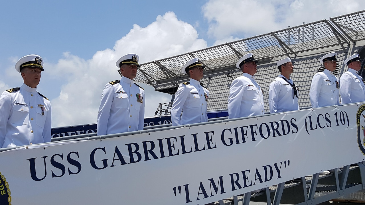 "The crew of the Navy's newest littoral combat ship, USS Gabrielle Giffords, ""mans the ship and brings her to life"" during a commissioning ceremony at the Port of Galveston, Texas, June 10, 2017. Gabrielle Giffords is the 10th such vessel to be commissioned and is named for former Arizona Congresswoman Gabrielle Giffords. Navy photo by Senior Chief Michael D. Mitchell"