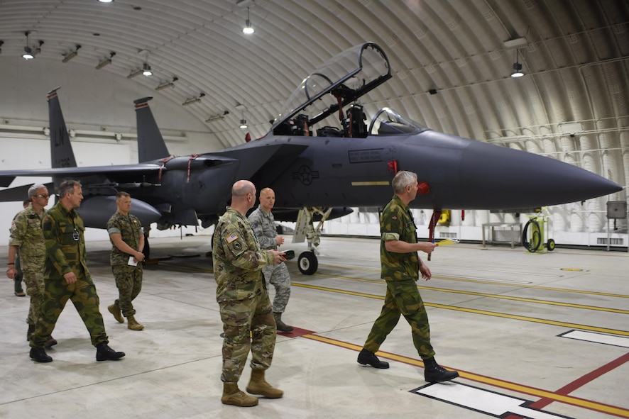Defense Threat Reduction Agency-On Site Europe team members perform a Conventional Armed Forces in Europe exercise inspection of a F-15E Strike Eagle protective aircraft structure at Royal Air Force Lakenheath, England, June 1. The CFE treaty was negotiated during the final years of the Cold War to limit the amount of combat equipment a nation had in their inventory, and provides for an inspection regime to verify holdings. (U.S. Air Force photo/Airman 1st Class Eli Chevalier)