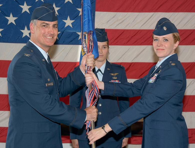 Lt. Col. Deirdre Gurry, right, accepts the guidon and command of the 8th Flying Training Squadron from Col. Paul Johnson, 71st Operations Group commander, during a change of command ceremony June 9, at Vance Air Force Base, Oklahoma. (U.S. Air Force photo/ Terry Wasson)