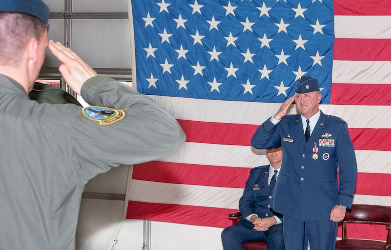 Lt. Col. Bryan Elder receives his final salute before relinquishing command of the 8th Flying Training Squadron to Lt. Col. Deirdre Gurry during a change-of-command ceremony June 9 at Vance Air Force Base, Oklahoma. (U.S. Air Force photo/ Terry Wasson)