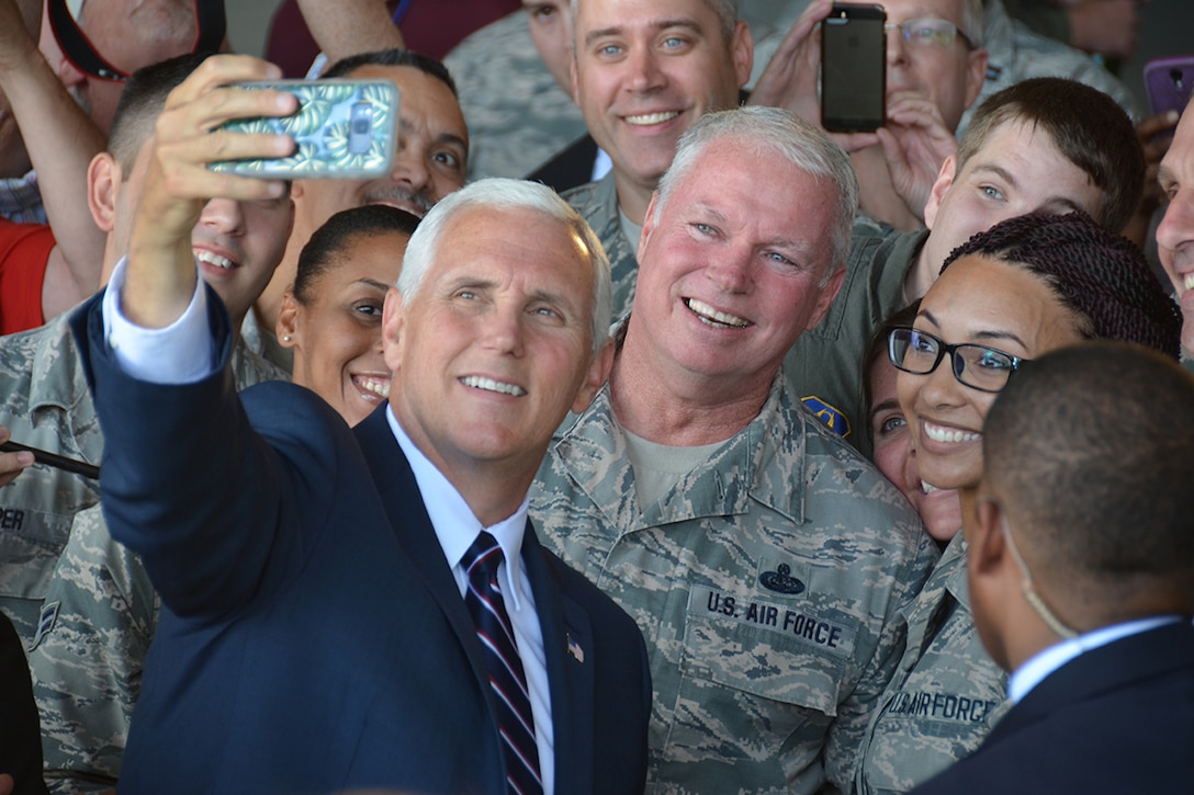 Vice President Mike Pence takes a selfie with military members during a visit to Dobbins Air Reserve Base, Georgia June 9, 2017. While recognizing it as the largest joint service training Reserve base in the world, Pence pledged the administration's full support of our service members and national defense. (U.S. Air Force photo/Tech. Sgt. Kelly Goonan)