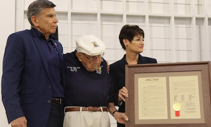 Retired U.S. Marine Corps Maj. Gen. Juan Ayala (left) and Texas Senator Dr. Donna Campbell (right) thank retired rmy Air Force Lt. Col. Richard E. Cole (center) for his service with the Doolittle Raiders May 20 at a World War I commemoration event at Brooks City Base Hangar 9. The event was hosted by the City of San Antonio Department of Military Affairs to honor those who served in World War I.