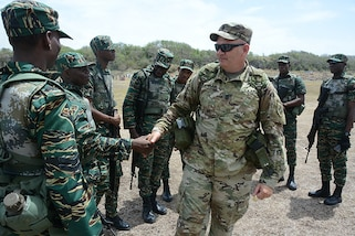 Army Command Sgt. Maj. Dave Lanham, 83rd Troop Command, Florida Army National Guard, encourages Guyanese troops prior to their turn on the range. Armed forces personnel from Barbados, Guyana, Haiti, Jamaica, Mexico, Surinam, Trinidad & Tobago and the U.S. participated in a Tradewinds 2017 range fire training exercise at Paragon Base, Barbados, June 11, 2017. Military personnel and civilians from 20 countries are participating in this year's exercise in Barbados, and Trinidad & Tobago which runs from June 6-17. (U.S. Army National Guard photo by 1st Sgt. Paul Meeker)