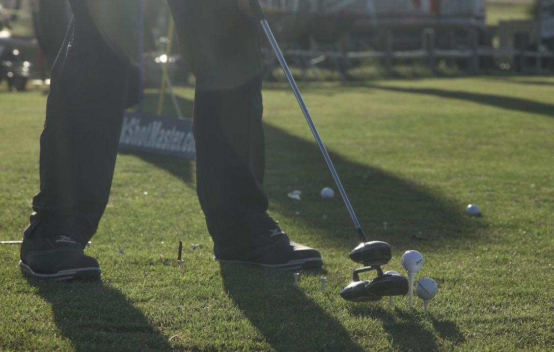 Peter Johncke, trick shot master, performs a trick shot during the Pro and Glow golf tournament hosted by Marine Corps Community Services at the Desert Winds Golf Course aboard the Marine Corps Air Ground Combat Center Twentynine Palms, Calif., June 2, 2017. MCCS invited Johncke to be a golf demonstrator at the event in order to show Combat Center patrons different ways to expand their golfing talents.