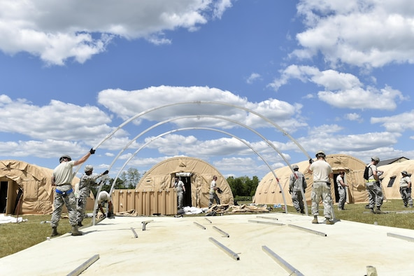 "Members from the 821st Contingency Response Group, work on setting-up ""tent city"" during Exercise Turbo Distribution 17-02, June 7, 2017, at Battle Creek Air National Guard Base, Mich.  Approximately 120 Airmen from the 821st CRG stationed at Travis Air Force Base, California, deployed as part of a Joint Task Force Port-Opening exercise, June 6-15.  (U.S. Photo by Tech. Sgt. Liliana Moreno/Released)"