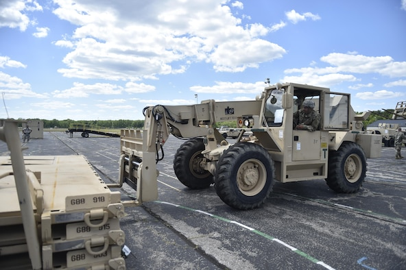 Spc. Matthew Avery, 688th Rapid Port Opening Element, moves equipment to the cargo staging area in preparation to move supplies to the forward distribution node, to establish a theater level logistics flow during Exercise Turbo Distribution 17-02, June 7, 2017, at Battle Creek Air National Guard Base, Mich.  The Joint Task Force-Port Opening element specializes in rapidly establishing hubs for cargo distribution operations worldwide, to include remote or damaged locations, on short notice.  (U.S. Photo by Tech. Sgt. Liliana Moreno/Released)