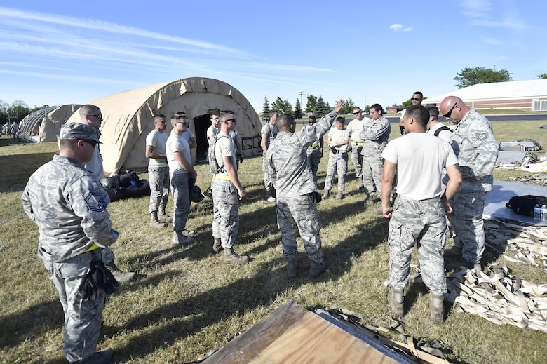 Aerial porters from the 821st Contingency Response Group get a mission brief during Exercise Turbo Distribution 17-02, June 7, 2017, at Battle Creek Air National Guard Base, Mich.  Approximately 120 Airmen from the 821st CRG stationed at Travis Air Force Base, California, deployed as part of a Joint Task Force Port-Opening exercise, June 6-15.  (U.S. Photo by Tech. Sgt. Liliana Moreno/Released)