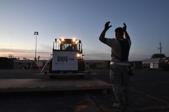 Staff Sgt. Jorge Hernandez, 821st Contingency Response Squadron aerial port supervisor, directs a forklift to the cargo staging area in preparation to move supplies to the forward distribution node, to establish a theater level logistics flow during Exercise Turbo Distribution 17-02, June 7, 2017, at Battle Creek Air National Guard Base, Mich.  The JTF-PO element specializes in rapidly establishing hubs for cargo distribution operations worldwide, to include remote or damaged locations, on short notice.  (U.S. Photo by Tech. Sgt. Liliana Moreno/Released)