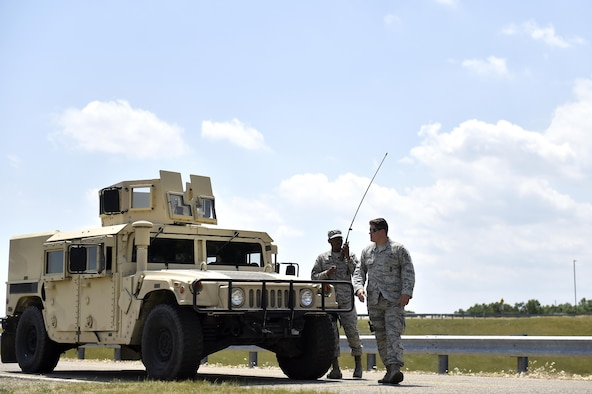 Airman 1st Class Calixto Mariano and Staff Sgt. Steven Armbright, 821st Contingency Response Group security forces, respond to a simulated accident during Exercise Turbo Distribution 17-02, June 9, 2017, at Battle Creek Air National Guard Base, Mich.  Turbo Distribution is used to evaluate mobility operations and expeditionary combat support. Unlike traditional, simulation based exercises, TD provides a dynamic venue with scenarios designed to challenge participants executing complex operations in a deployed environment.  (U.S. Photo by Tech. Sgt. Liliana Moreno/Released)